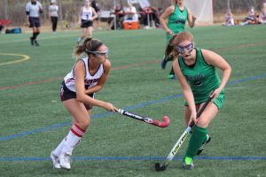 Senior Erin McCarthy strips glides passed Drake defender and moves the ball down the field