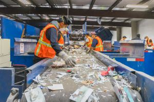 Workers at Marin Sanitary Service work hard to sort all the recycled material that passes through their building.