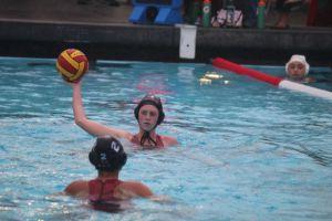 Senior captain Makenzie Allen looks ahead as she passes to her teammate.