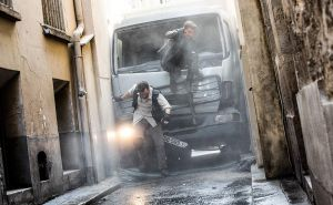 Ethan Hunt (Tom Cruise) and August Walker (Henry Cavill) abandon their destroyed truck to continue on foot.