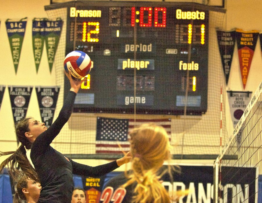 Junior Sophie DiGrazia taps the volleyball over the net in the middle of the second game on Friday in Ross.