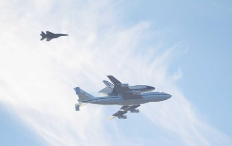 Endeavour space shuttle soars over parking lot