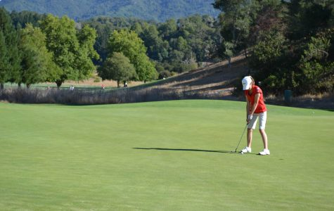 Olivia Poletti sinks a put on the first hole green during a match against drake on Tuesday, Sept. 4.