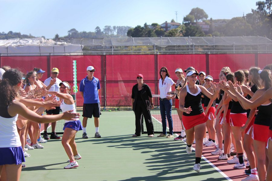 The varsity girls' team prepares to face Tam in the MCAL match up last Thursday.