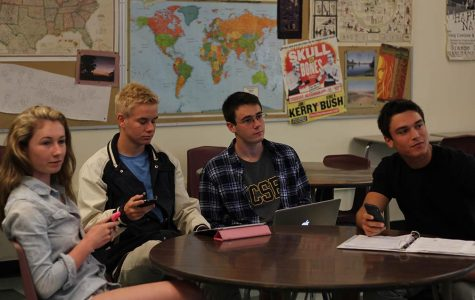 SENIORS KENDALL FULTON and Joe Gray and juniors Cade Groesbeck and Julian Goldman use a variety of social media forums, including Instagram and Twitter, to complete assignments in Morris' Essay Exposition class.