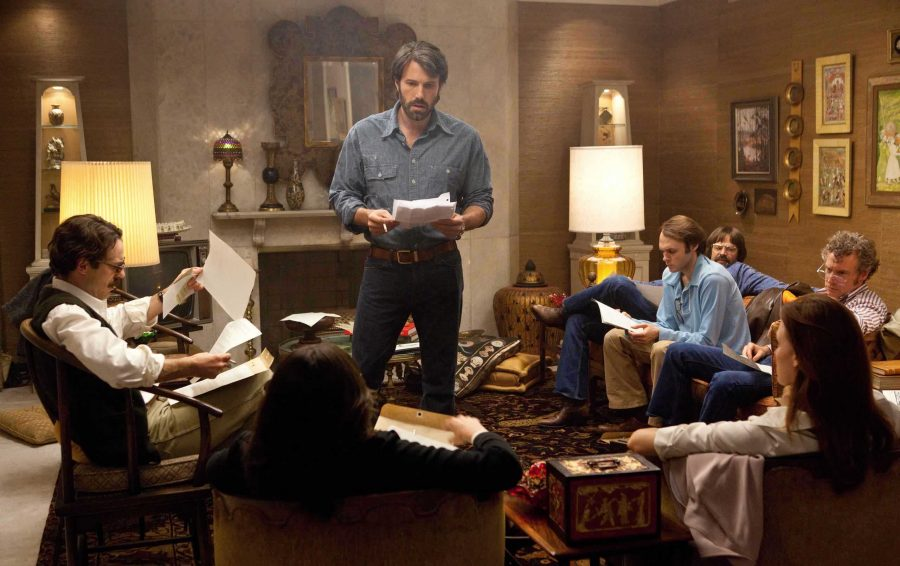 CIA Agent Antonio Mendez (Affleck), center, directs the six American hostages as the seven try to escape the violence in Iran.