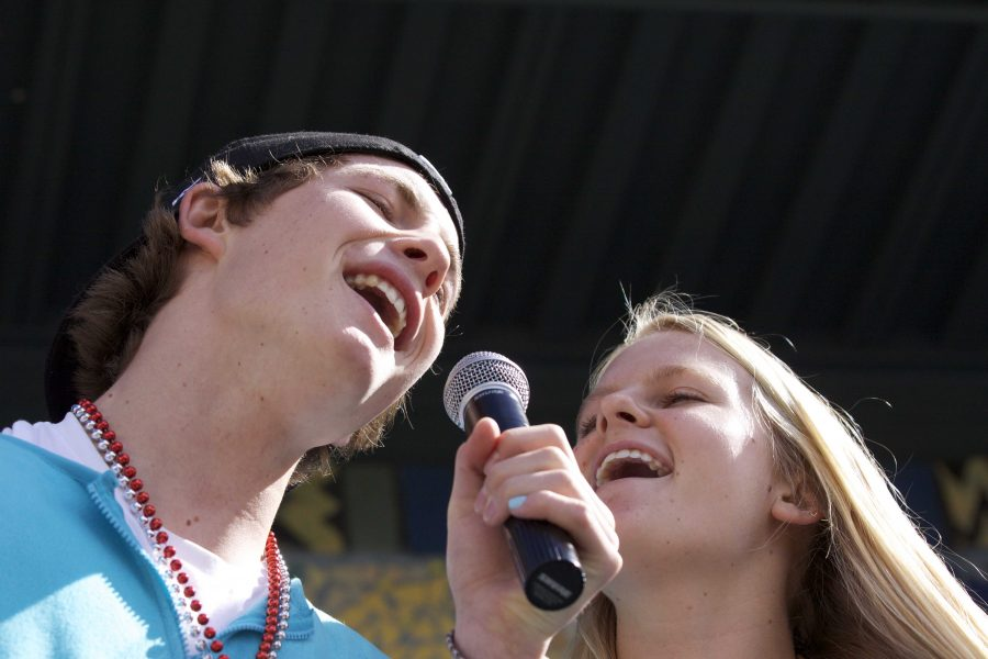 Olivia Kontinnen and William Simmonds sing during the lunchtime karaoke competition on Tuesday, which was also pajama day.