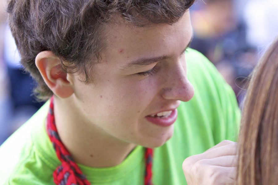 Douglas Pardella makes over his partner Celeste Carswell during Wednesdays lunchtime make-over contest. Wednesday was also Neon Day.