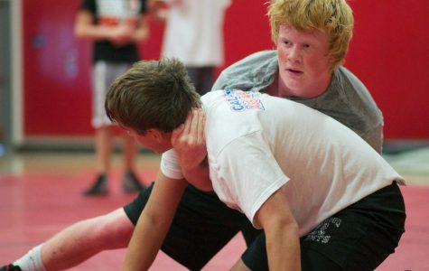 Senior Jack Twomey grapples with fellow senior Will Amos during a practice prior to last weekend's tournament against Northern California.