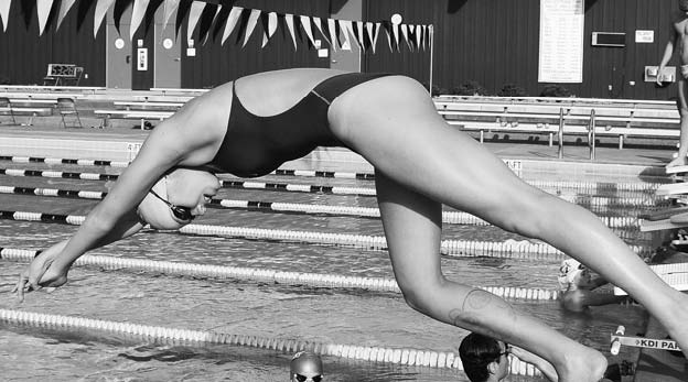 Diving into the water, freshman Emma McCarthy practices in preparation for Junior Nationals next week.