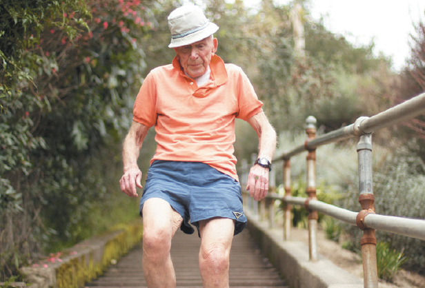 "Zvi Danenberg climbs up the Larkspur stairs as a part of his daily routine, sporting his trademarked ""crooked hat."""