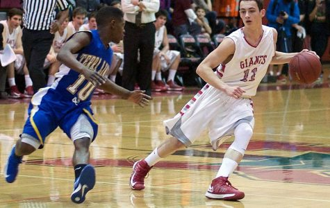 Varsity boys' basketball defeated in final seconds on game night