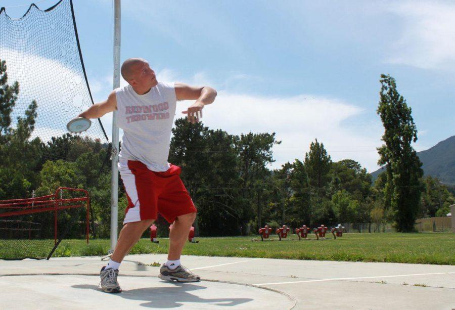 Redwood graduate Sam Perrella practicing discus during his senior year of high school.