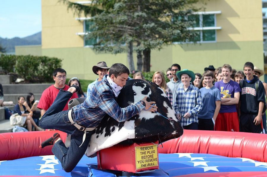 Gallery: Students ride mechanical bull during spirit week