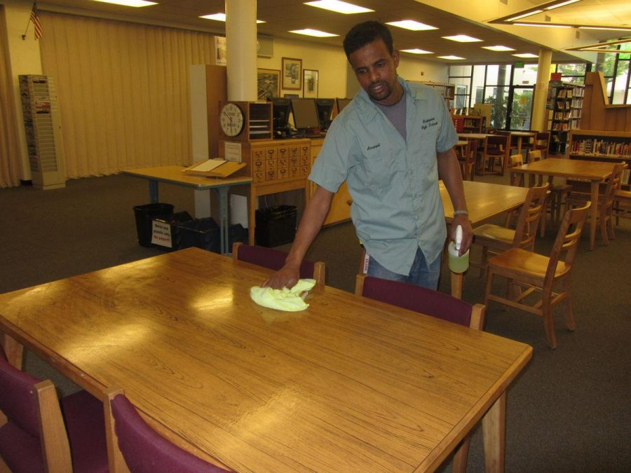 Custodian Amanuel Gebremichael cleans the library after school. He moved to California from Eritrea in 2001 and has lived here ever since.