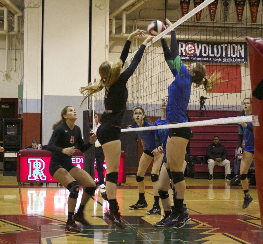 A REDWOOD VOLLEYBALL player blocks a kill from a Branson player. Redwood lost to Branson in five sets last night.