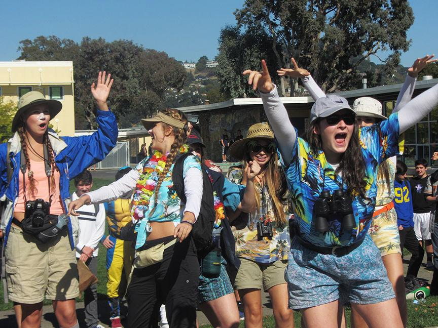 Best group costume winners, the Tourists, celebrate their victory.