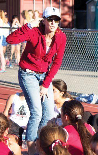 Coach Laura Schmitt motivates the team before the October 3 meet. The meet was relocated from Tennessee Valley to Redwood because of the government shutdown.