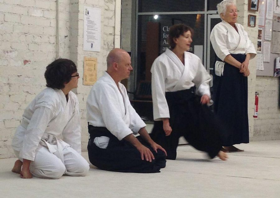 Sophomore Jonah Goodman sits awaiting instruction during his aikido class