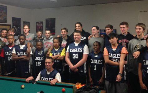 Boys varsity basketball donates to underpriviliged students