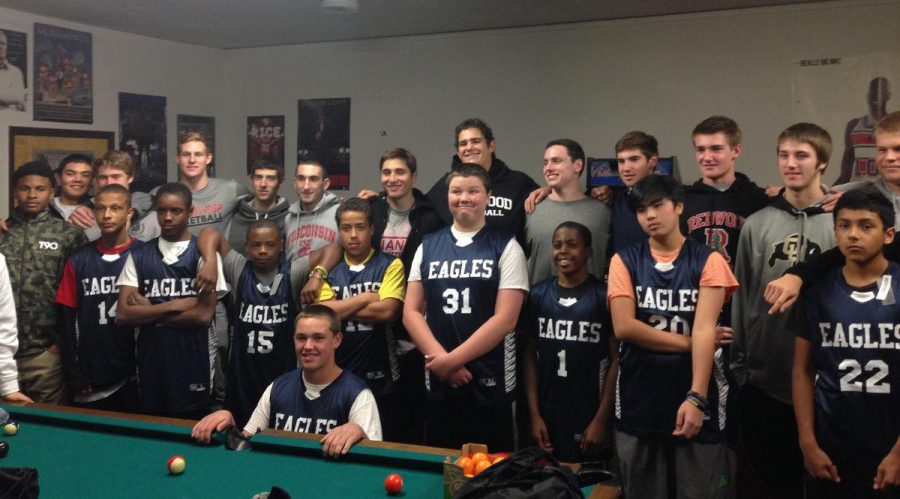 Boys varsity basketball donates to underpriviliged students