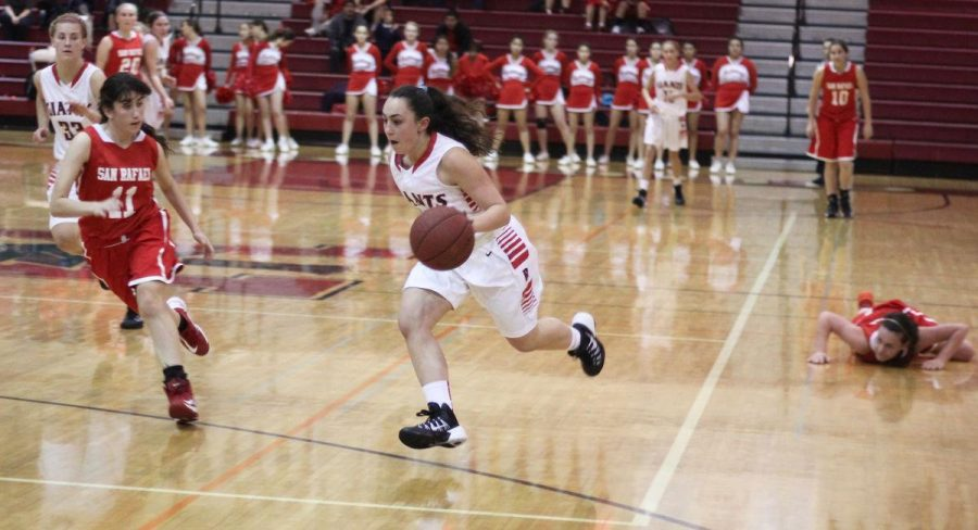 Junior Danielle McCauley drives toward the basket on a fast break opportunity.