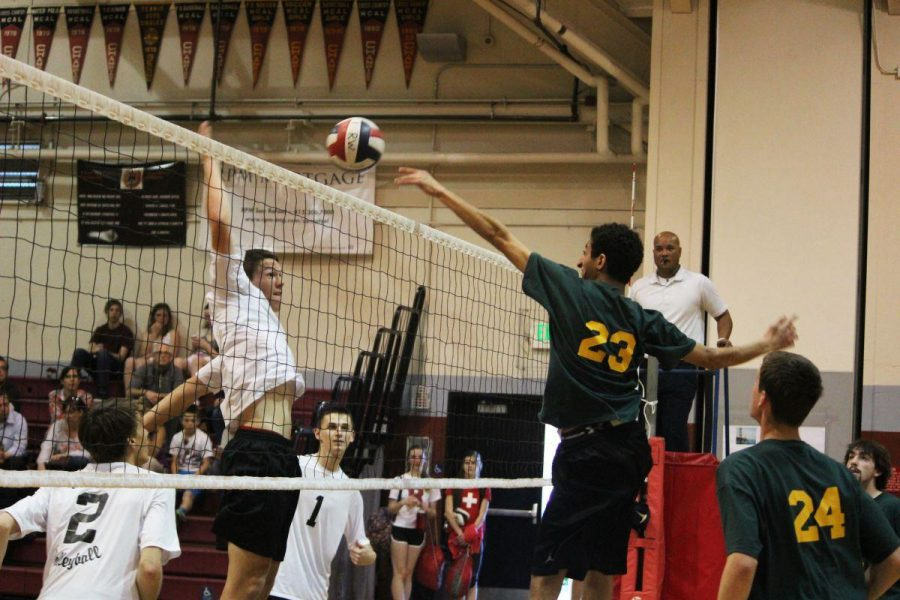 SENIOR LUKE PFEIFFER hits into a block by San Marin at the men's volleyball game last Wednesday.