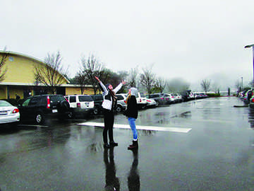 Students rejoice in the much-needed rain after a dry spell.