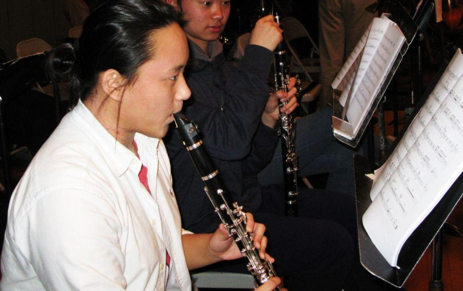 Senior Jane Bhan plays clarinet at rehearsal for the Young People's Symphony Orchestra in Berkeley.