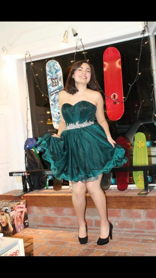 Sophomore Bella Vega sports one of the dresses at Live Water Surf Shop