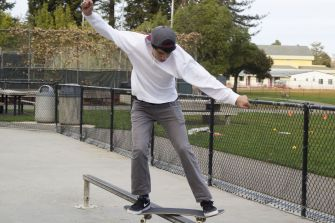 SOPHOMORE MICHAEL GONZALES grinds on a rail in Corte Madera's skate park.