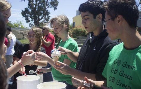Scooping ice cream for ravenous students, Environmental Action Club members bribes the student body to stay on campus during lunch on May 22.