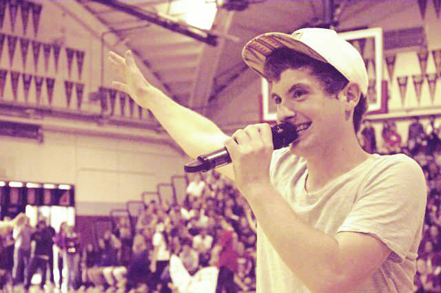 """Senior Nick Lopez sings his original song, """"Back in the Day,"""" at the Spring Rally last Thursday."""