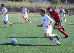 Junior Isaac Perper dribbles the ball during Wednesday's game versus Marin Academy.