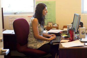 Redwood's new Wellness Director Jessica Colvin works at her desk.