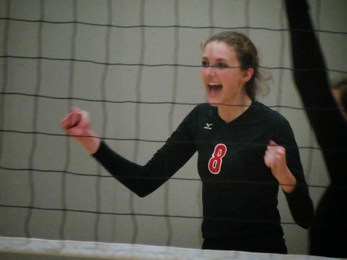Sophomore McKenzie Cooke celebrates the teams win.