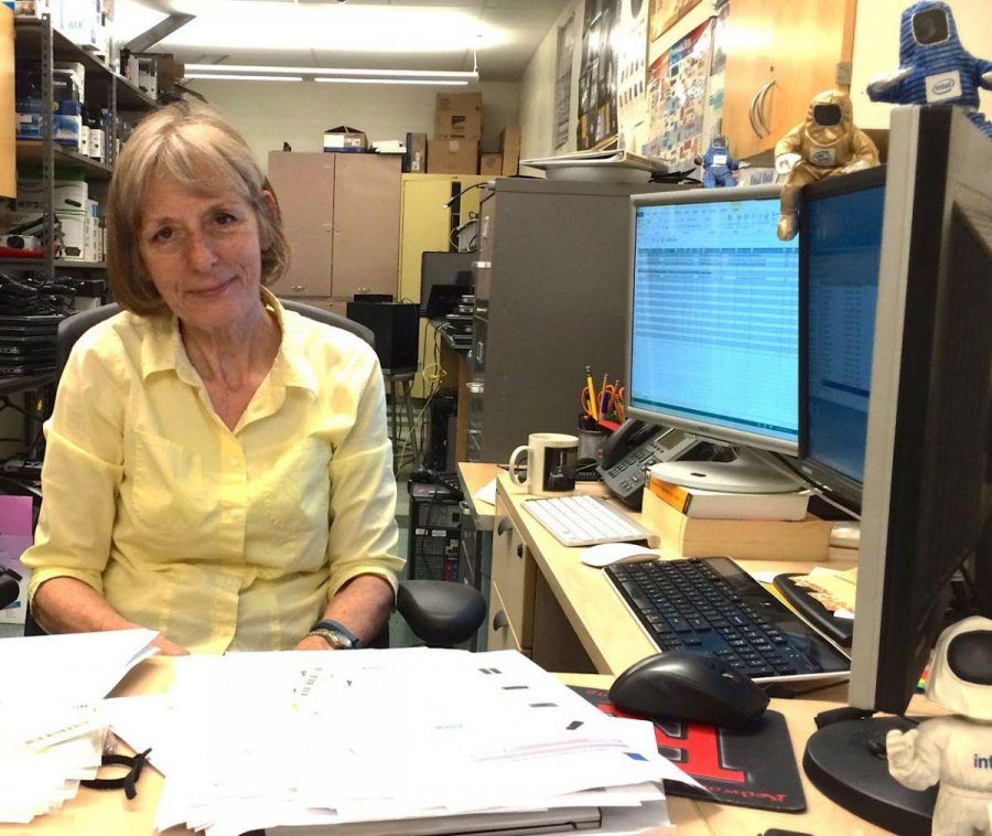 School IT specialist Becky Matsubara, who will retire at the end of the month, sits at her desk in room 160.