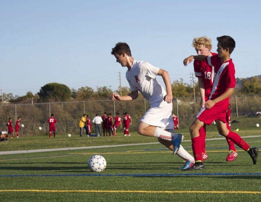 Junior Julian Ulrich takes the ball towards the goal.