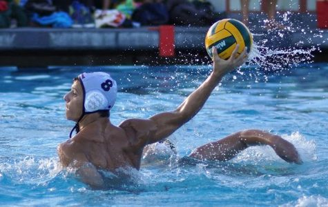 Captain Giorgio Cico winds back for a powerful pass up the pool.