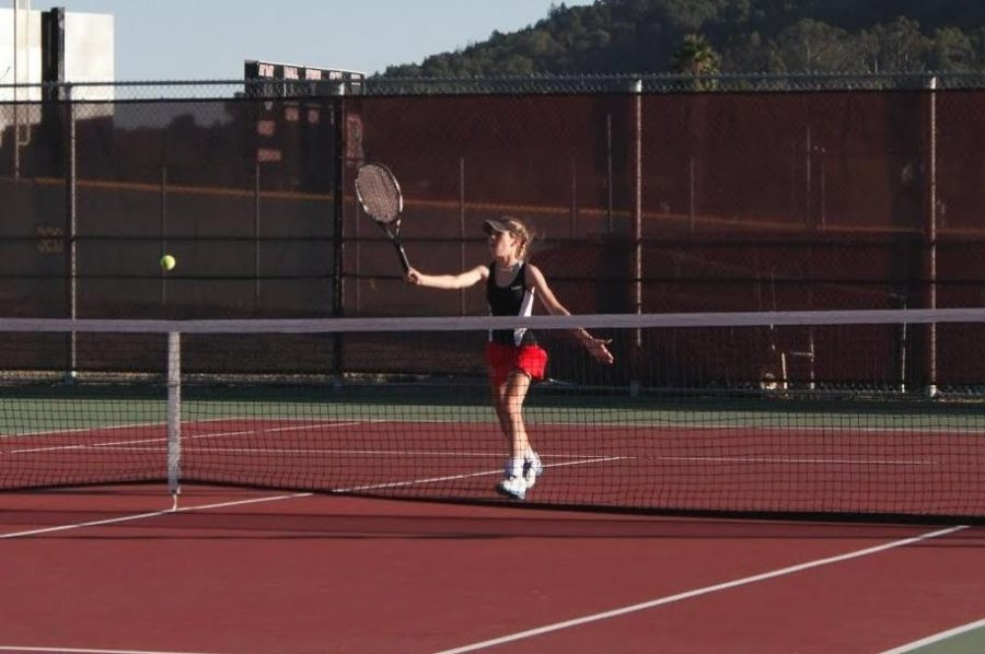 Freshman Rose Cabi competes in the varsity tennis match on Thursday, Oct. 2.