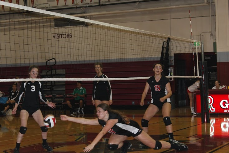 Freshman Abby Herron (#35) dives for the volleyball.