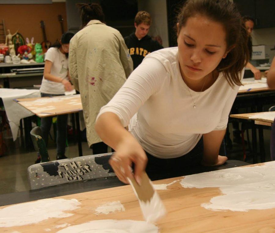 Sophomore Tara Antee paints one of the sets on Wednesday, Oct. 15.