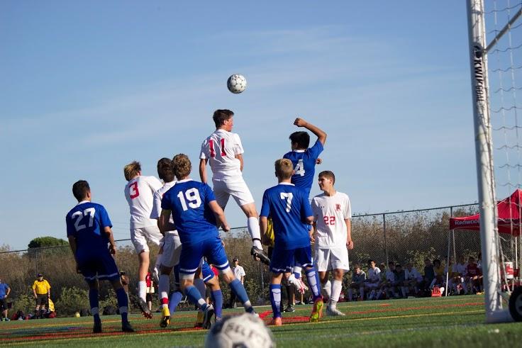 Sophomore Jack Elders heads the ball.