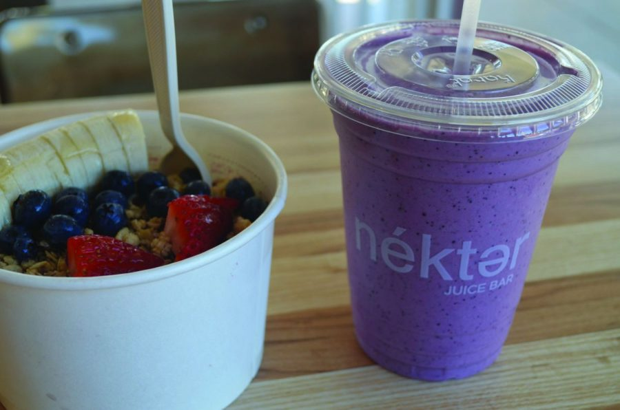 """NÉKTER, A NEW juice shop located in Strawberry Village, sells an acai bowl topped with granola, bananas, blueberries, and strawberries for $6.95, and a 16 oz. """"Berry Banana Burst"""" smoothie for $4.95."""