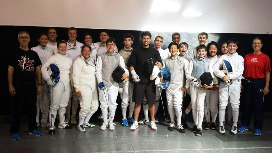 Cameron Sullivan, fourth from the left in the top row, poses with his fencing team.
