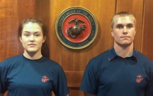 Mikayla Durtschi stands next to a fellow recruit after taking the oath of enlistment.