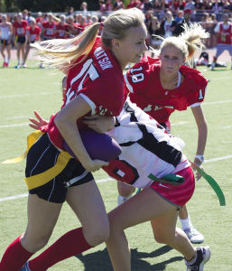 Emma Gallagher, a senior last year, attempts to pass junior Megan Rios in last year's Powder Puff game.