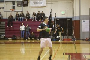 Junior Nate Orwig prepares to throw the ball down the court, later winning the game.