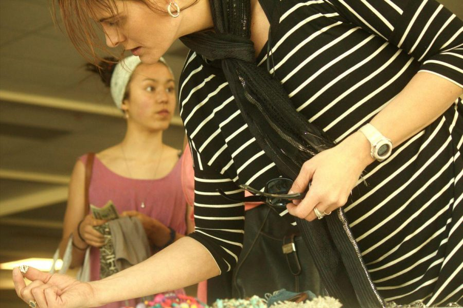 Teacher Stacey Goodwin browses the jewelry table at the Thrift For Hope used clothing sale on Saturday Nov. 15.