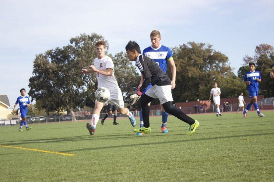 Junior Julian Ulrich approaches the goalie, attempting to make a shot on goal.